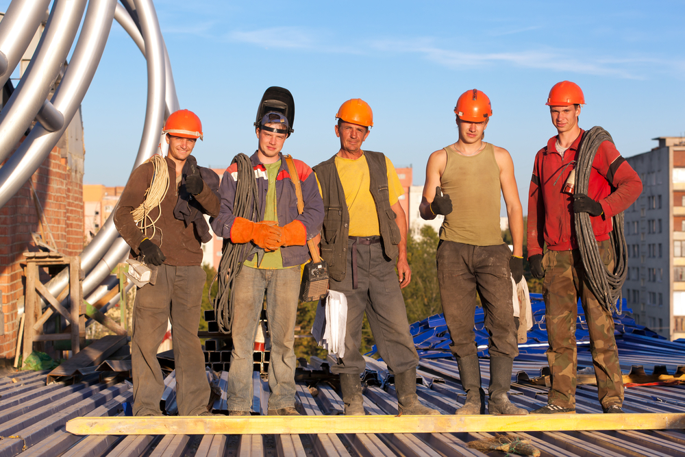 Group of construction workers at building site